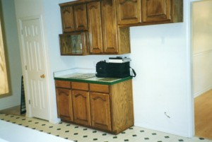 Kitchen before remodeling with faux stone panels