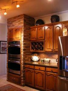 Kitchen remodeling with faux stone panels