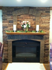 Class A Fire Rated faux stone panels capture the look of real stone in this fireplace design