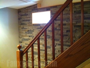 Stone veneer wall panels added to a finished basement