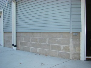 This home's exterior wainscoting was bland and boring concrete block.