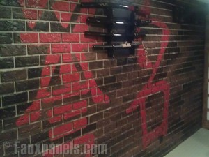 Oriental murals painted on brick panels for a basement remodeling project featured on Man Caves.