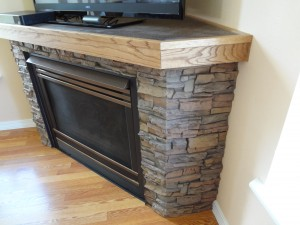Fireplace with mitered corners at a 45 degree angle to fit to the wall beautifully.
