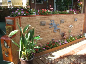 Faux stone planters made from  polypropylene siding panels