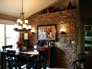 Making use of lighting elements and a faux stone accent wall, this customer's design plan served to enhance his dining room and highlight their wine collection.