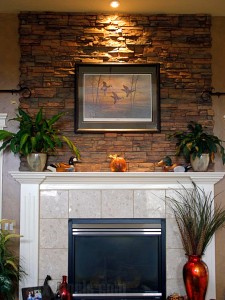With the addition of a faux stone accent above the fireplace, these customers completely changed the ambience of their room.