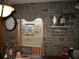 Kitchen wall remodeled with ledgestone paneling for a French country farmhouse look.