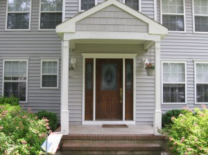 Neal's old, original front entranceway was boring and dated before he added panels.