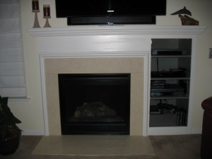 BEFORE: Dated and drab, the original fireplace was in dire need of a new look.