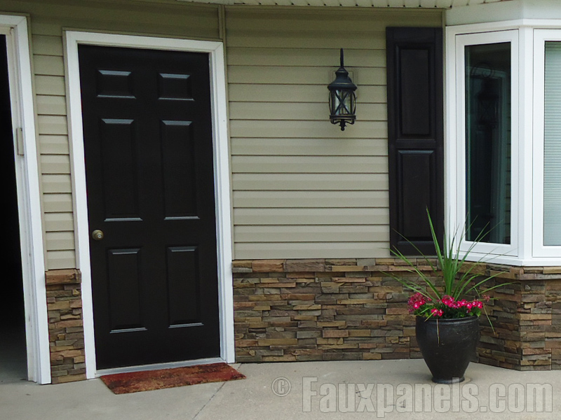 Home front entrance with stacked stone wainscoting