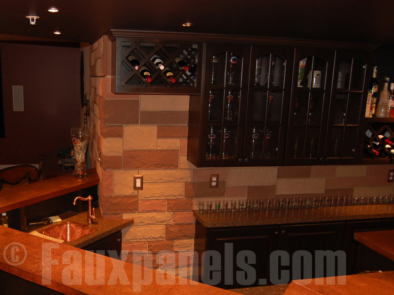 Home bar with random rock backsplash
