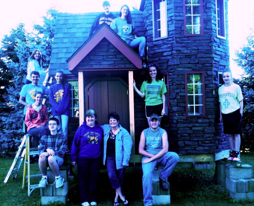 Venture Crew 630 stands proudly with their Enchanted Castle of Dreams.