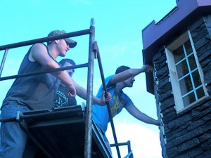 Venture Crew 630 members installing siding to the Enchanted Castle of Dreams
