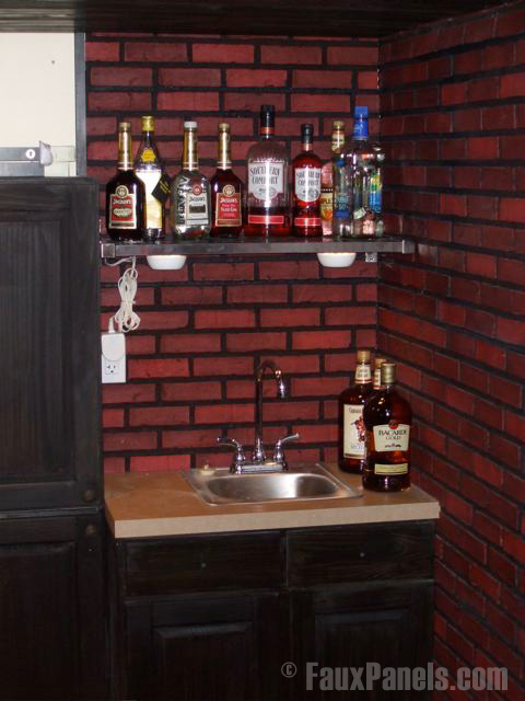 Brick look backsplash installed behind a mini bar and sink