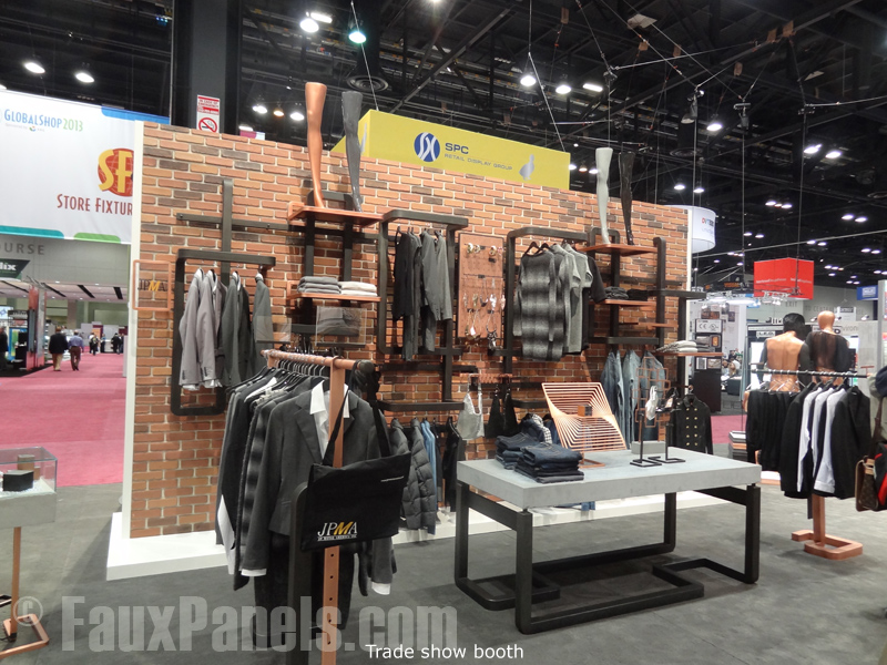Brick panels on a clothing store's trade show display.