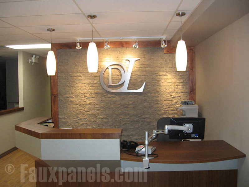 Reception area ideas can be enhanced with simulated stone accent walls.