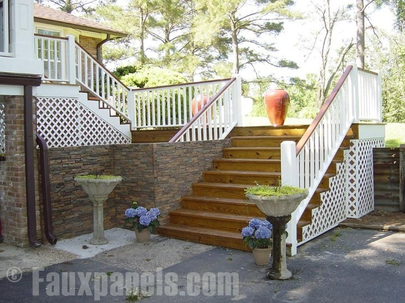 A home's elegant side steps look great framed with faux stone siding.