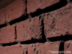 Extreme close up view of faux brick facing, simulating the look of real brick to an amazing degree.
