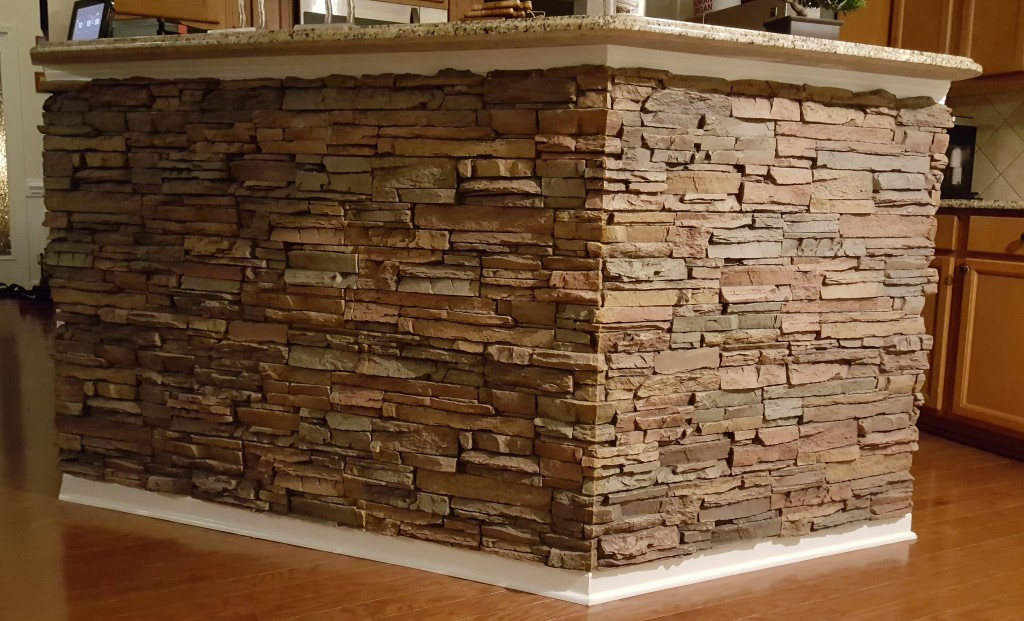 Kitchen counter makeover with stacked stone panels added to the counter wall