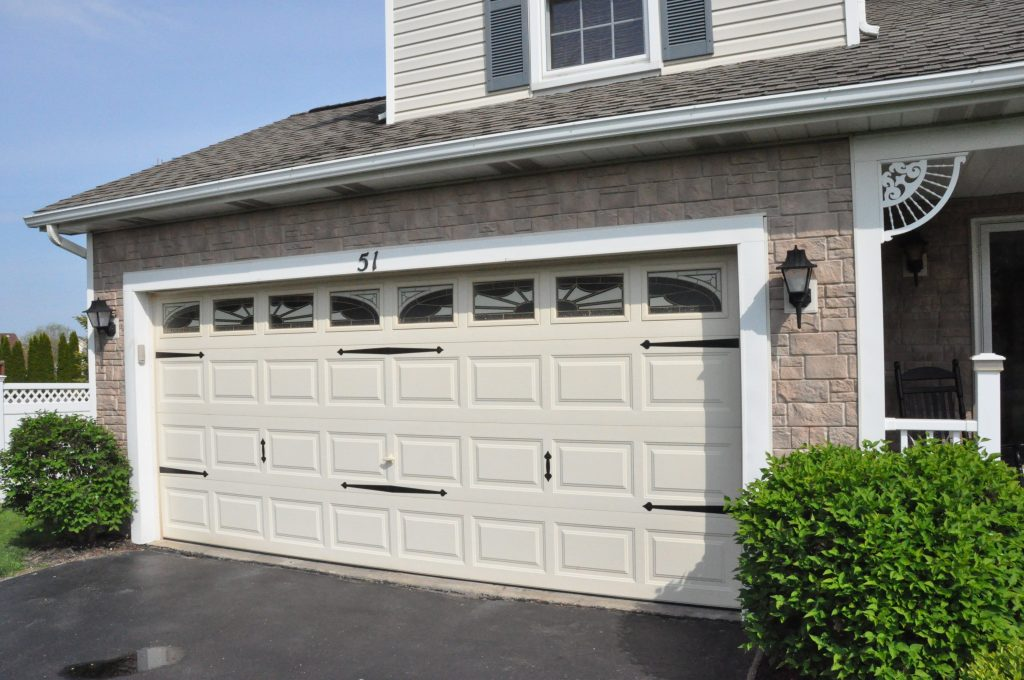 Replacing the vinyl siding with faux rock on parts of this Rochester, NY home gave it an exciting new look.