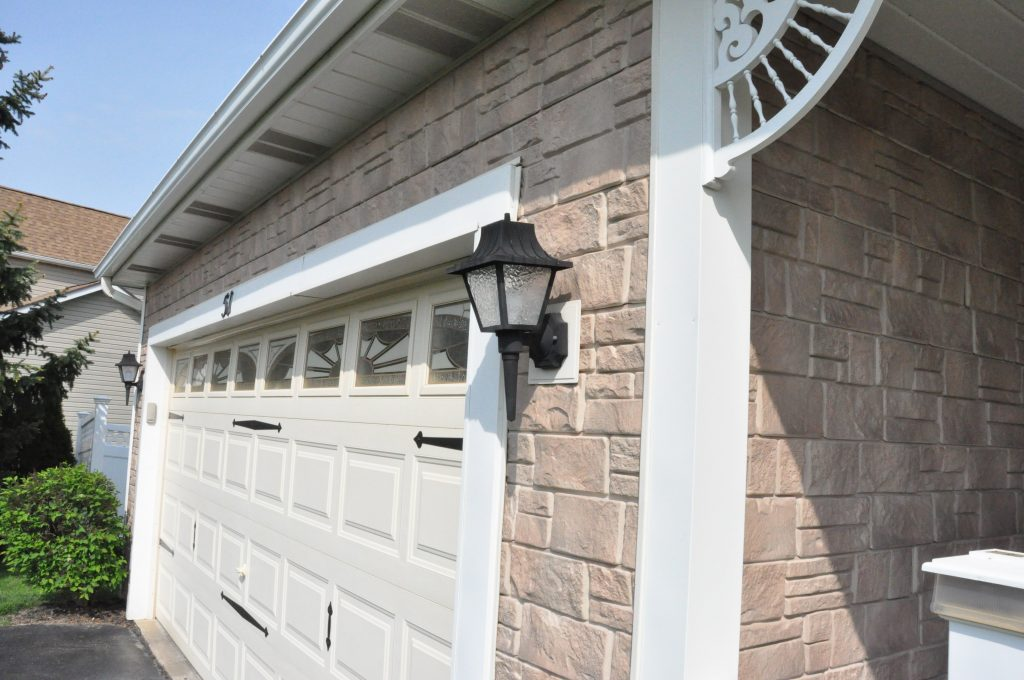 Close up view of Random Rock panels installed on a home garage's exterior.