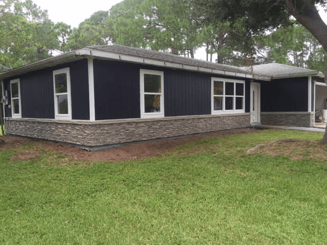 Home exterior makeover finished in just two days with stone style paneling, corner pieces and ledgers.