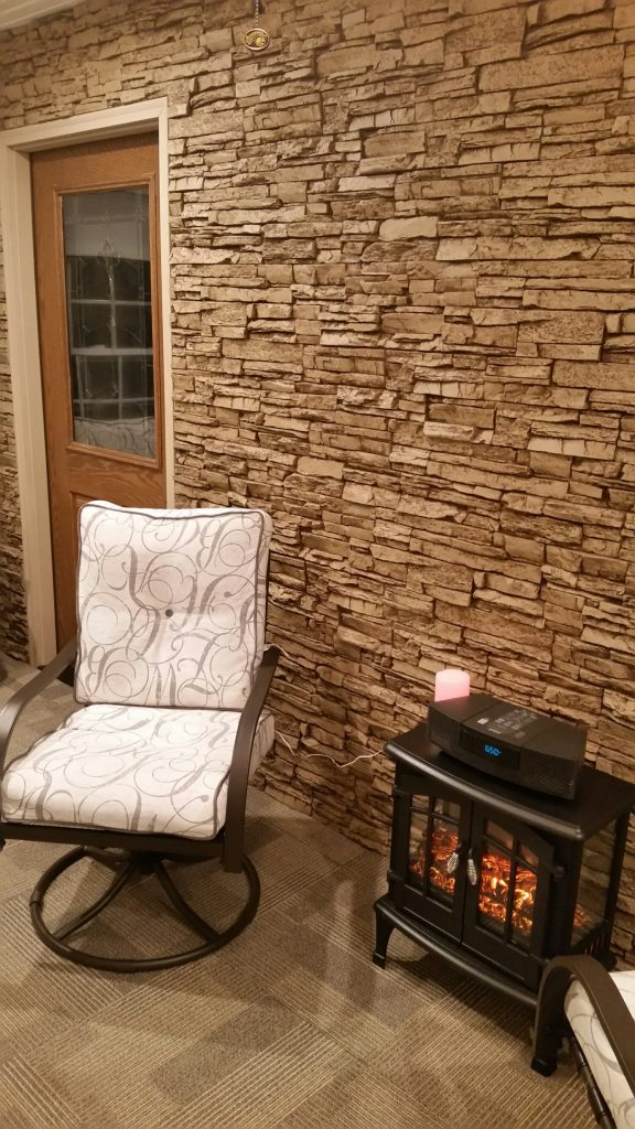 Sunroom wall covered in golden-hued stacked stone panels.
