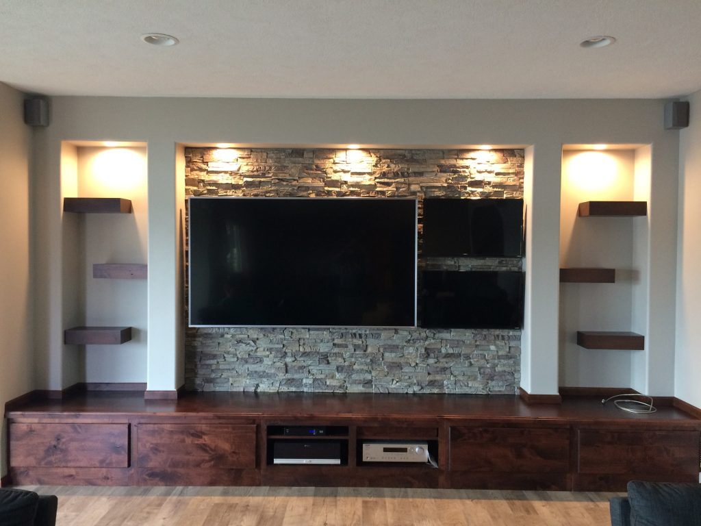 Rustic man cave's new media center finished with Regency Stacked Stone panels in Misty Morning color.