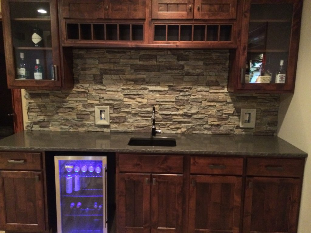 Man cave bar with new backsplash created with Regency Stacked Stone panels and matching outlet covers.