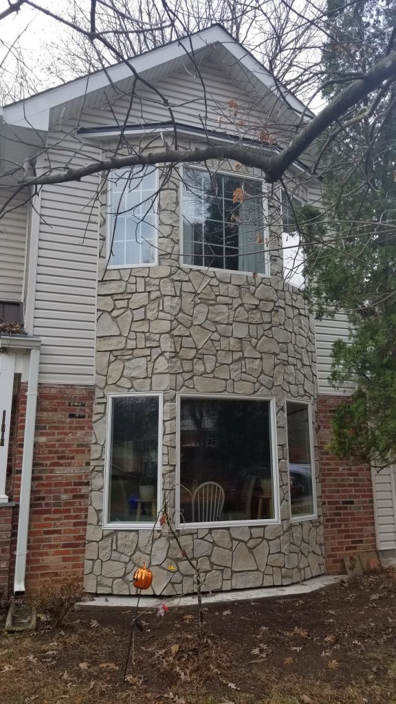A home's bay window exterior design enhanced with Carlton Fieldstone panels.