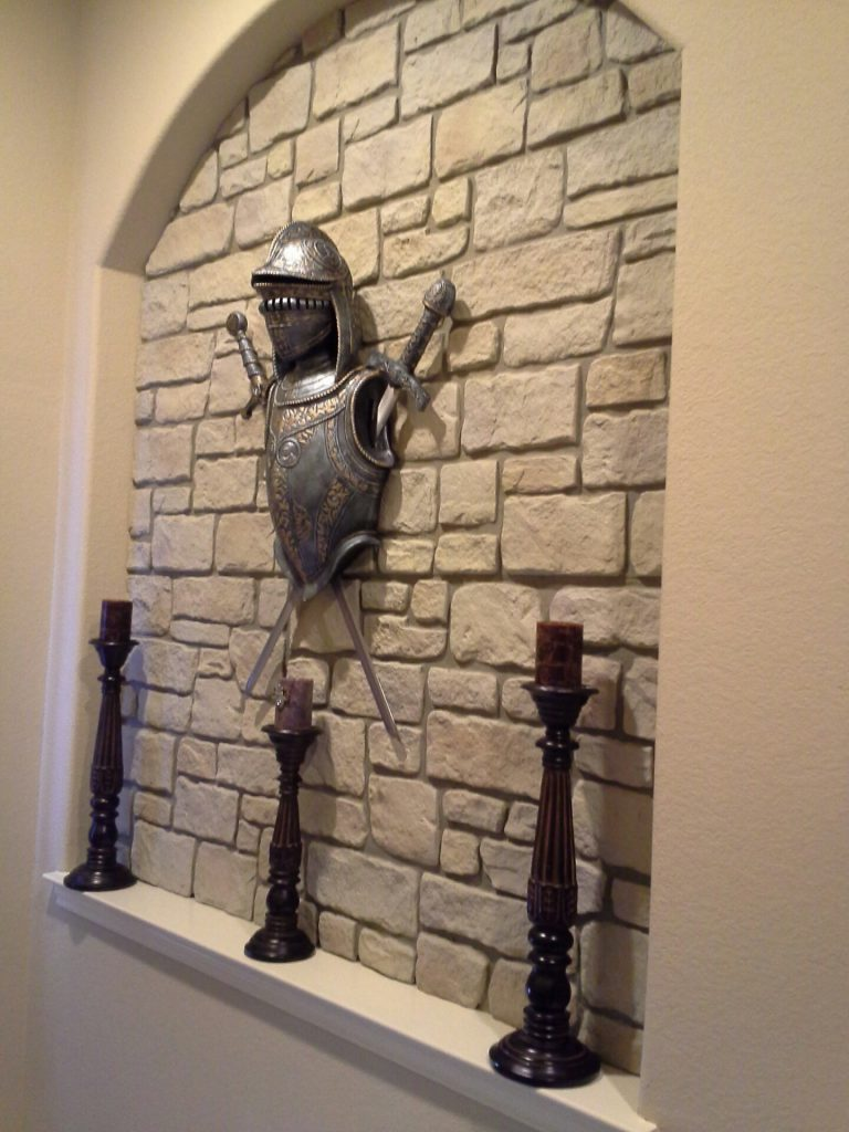 Medieval style accent wall design using Carlton Cobblestone panels.