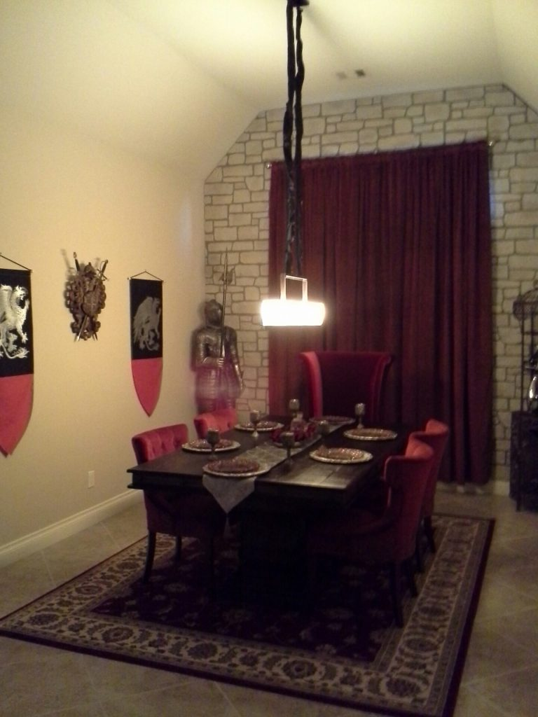 Medieval accessories like a red velvet drape and shields in the dining room helped complete the look.