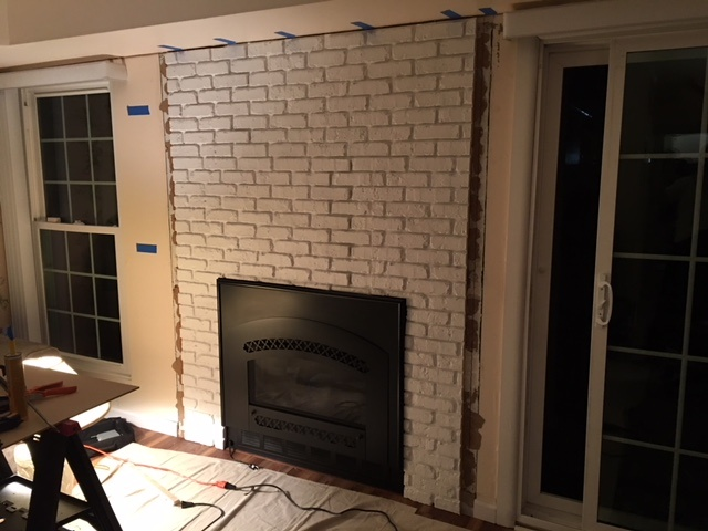 Allan cut the panels to fit around the recessed fireplace.