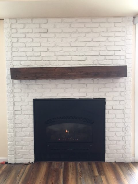 The final details were to add the edges to the fireplace with additional panel material and the faux wood mantel.