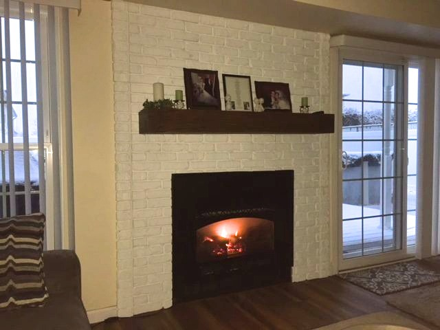 White brick fireplace created with Regency Old Chicago Brick veneer panels.