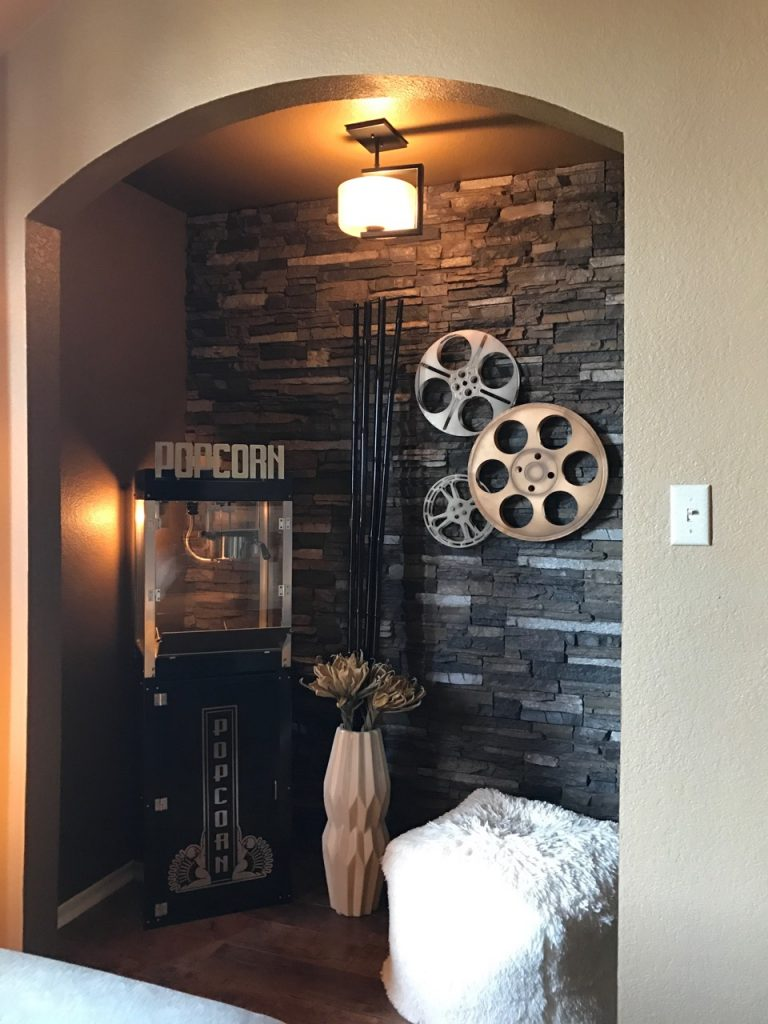 Movie room complete with popcorn machine and panels in Iced Coffee color in the alcove space