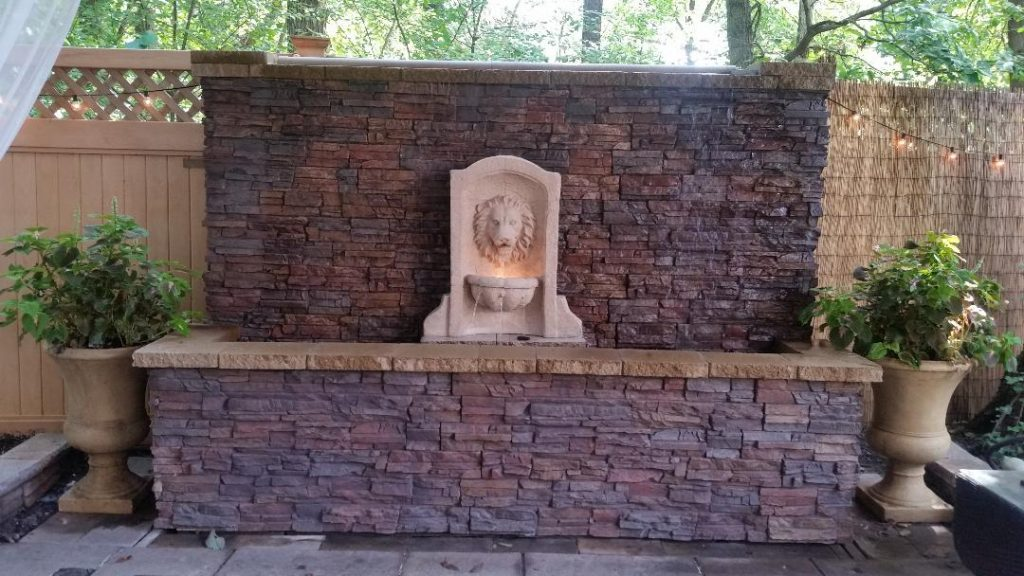 Backyard water wall covered in Regency Stacked Stone panels.