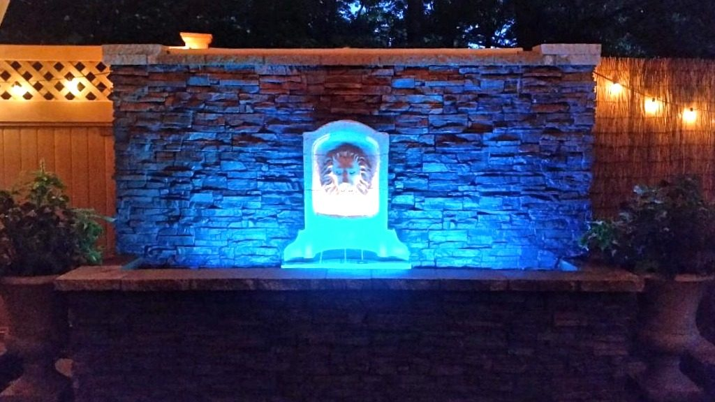 Water wall with blue LED lights, the cables and wires hidden behind the faux panels attached to the surface.