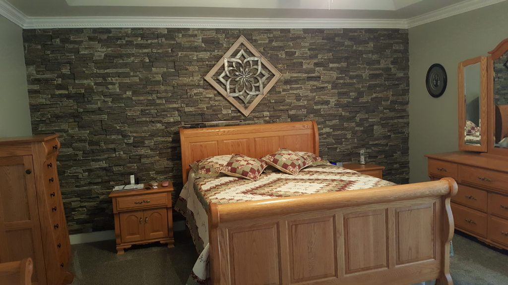 A simple, yet elegant bedroom wall design created with Regency Stacked Stone panels in Birchwood color.
