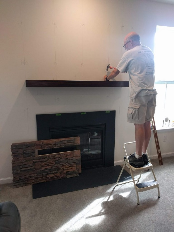 The mantel was installed flush with the wall.