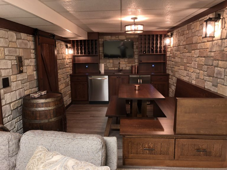 French-style tavern built in a home's basement with Carlton Cobblestone panels on the walls.