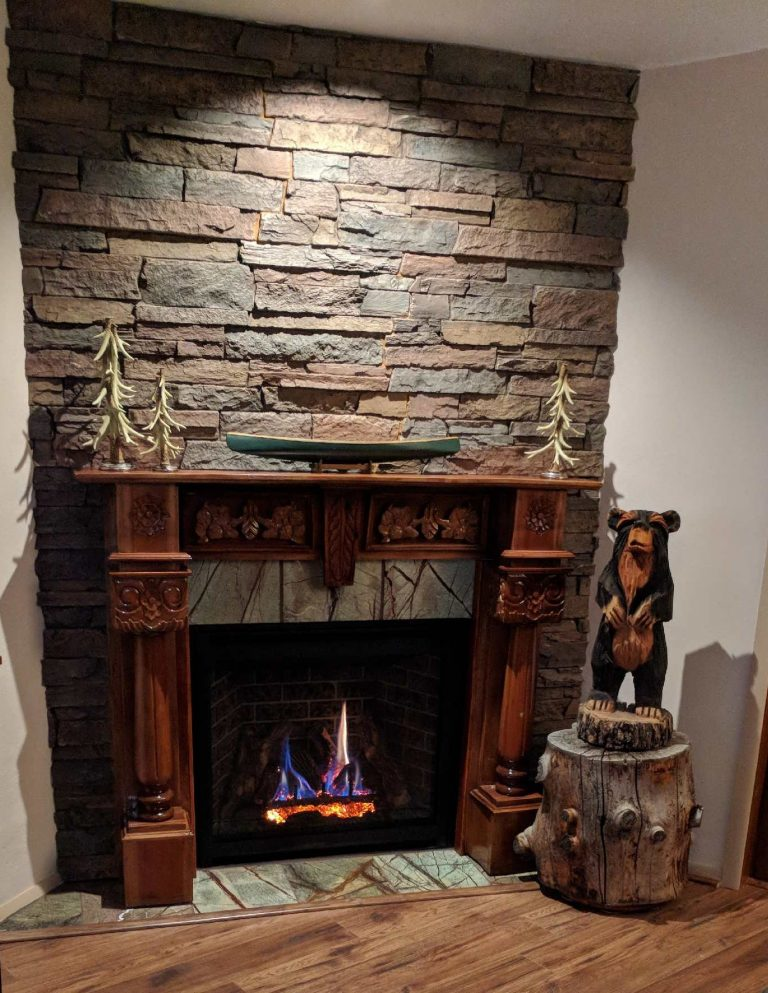 Fireplace surround made with Norwich Stone Wall panels in Earth color.
