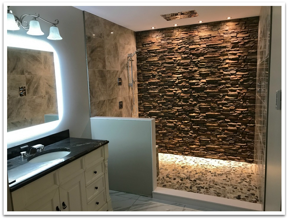 Shower remodeled with Norwich Stacked Stone panels in Earth color.