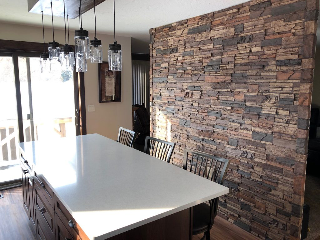 Stone-style kitchen accent wall created with lightweight Norwich Dry Stack panels.