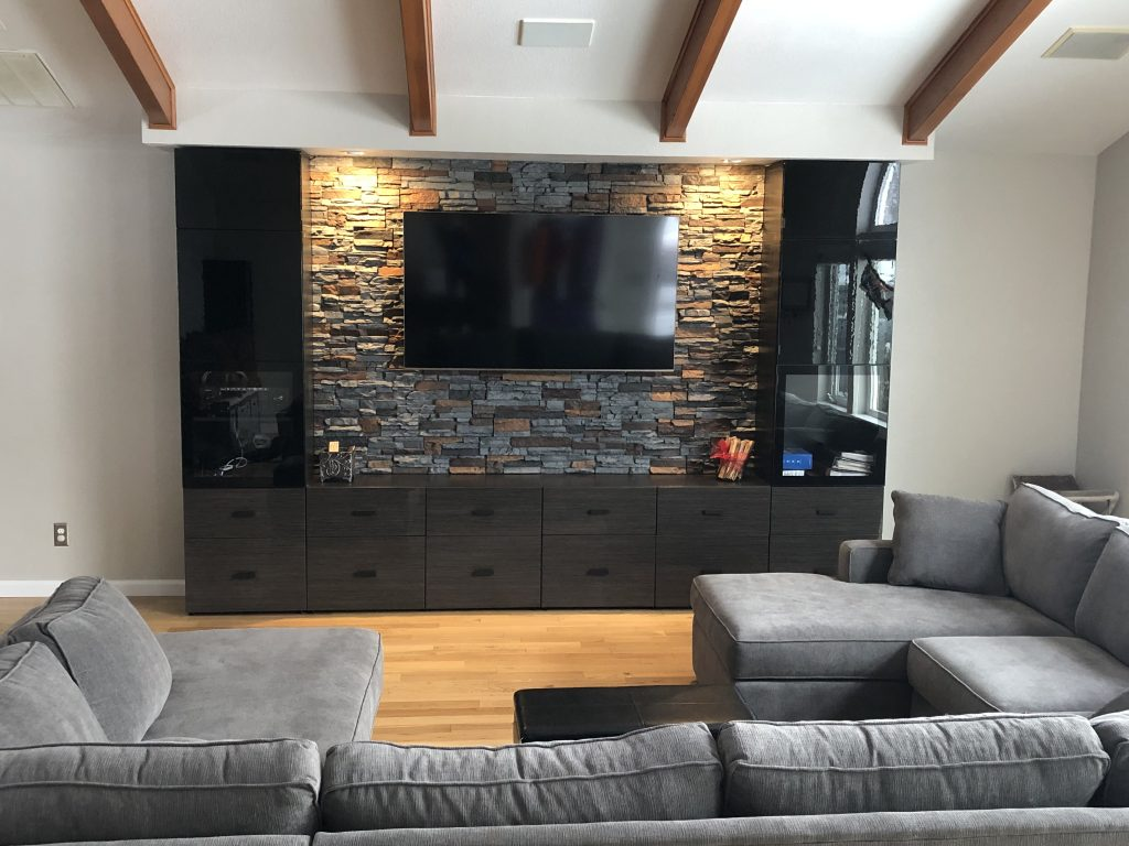 Home media center featuring a stone style feature wall.