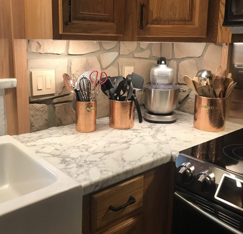 Creating this backsplash with faux Fieldstone was more practical and cost-effective than using real stone.