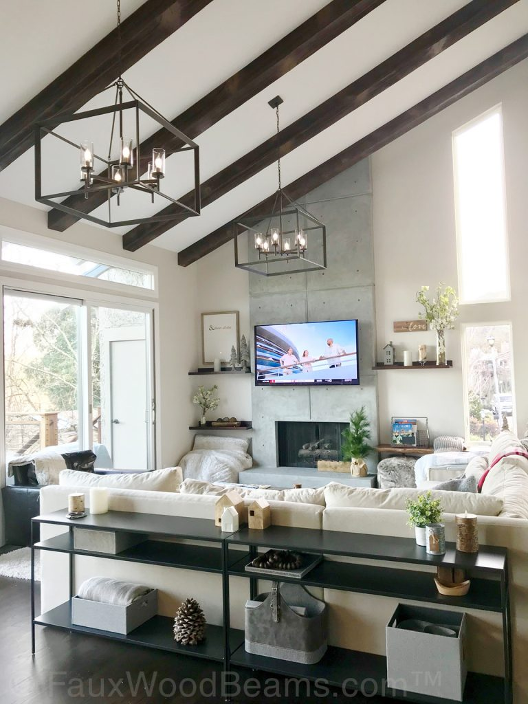 Modern living room with rustic accent beams on the high vaulted ceiling.