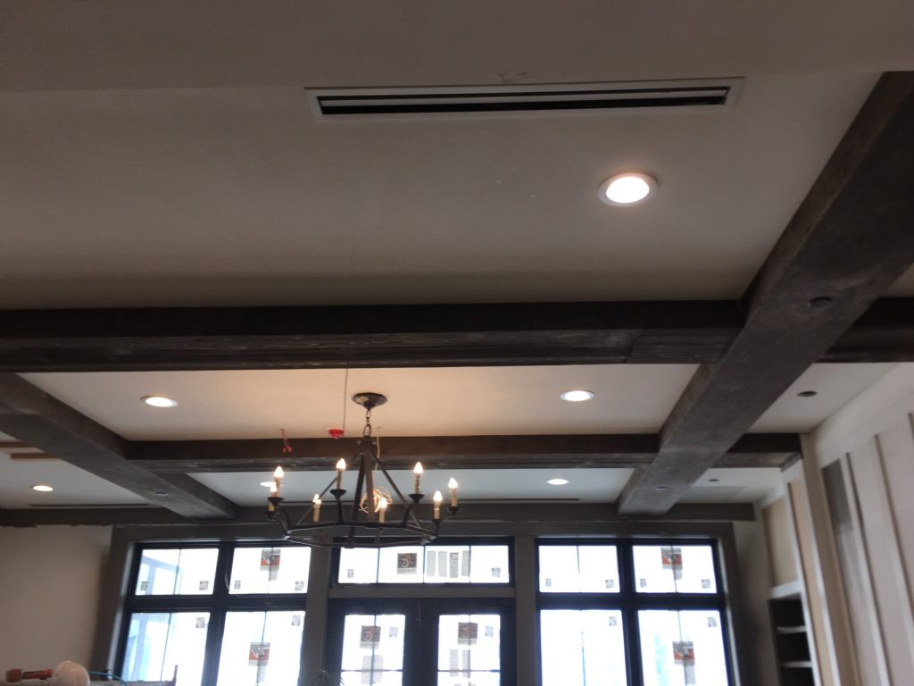 Virgin wood box beams finished to look like real antique wood, nicely complementing a home's historic aesthetic.