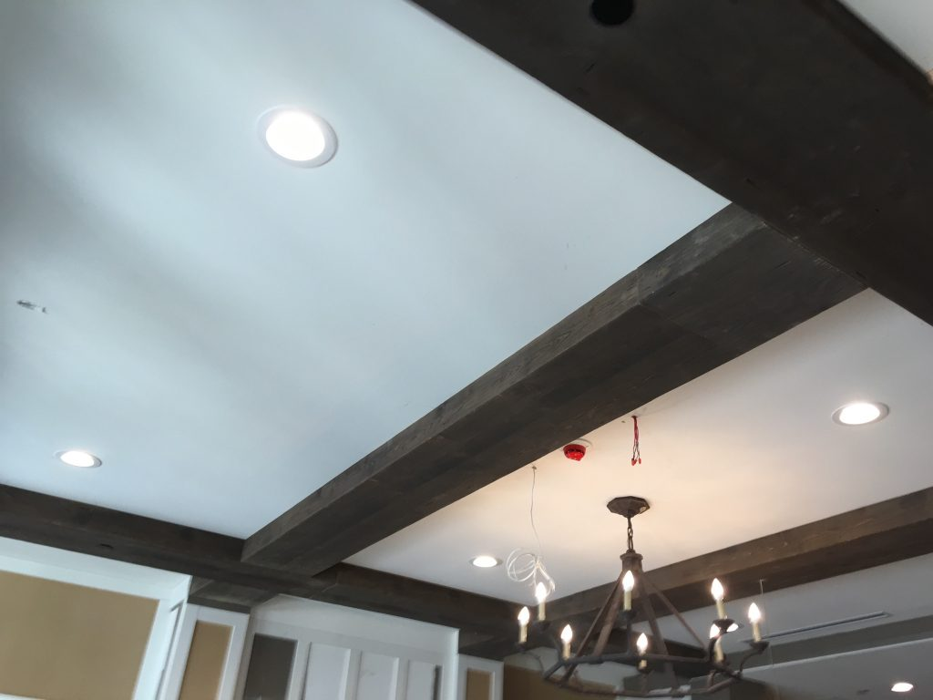 A home with historic style added Barn Board beams in Cocoa to their living room ceiling.