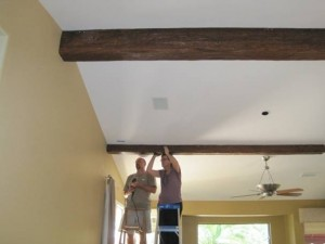 Installing faux timber beams on a kitchen ceiling